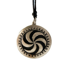 Tin pendant with picture stone design: sun wheel. Small